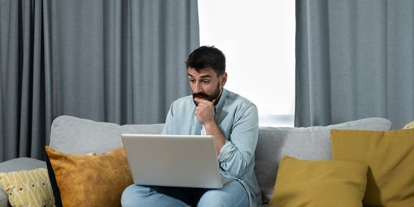Young Male Attending An Online Therapy Program