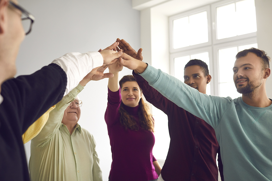 Team of diverse people participating in corporate team building activities