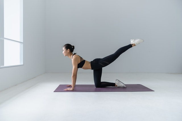 Woman attending online classes for yoga
