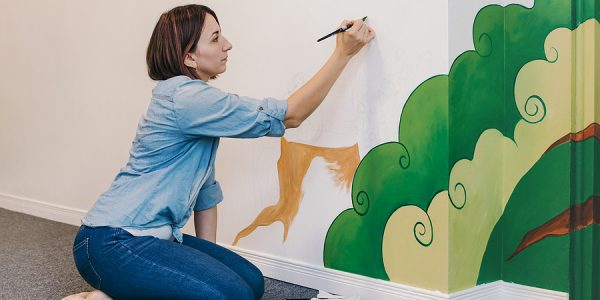 Mural Painter Painting On Indoor Walls Of An Apartment