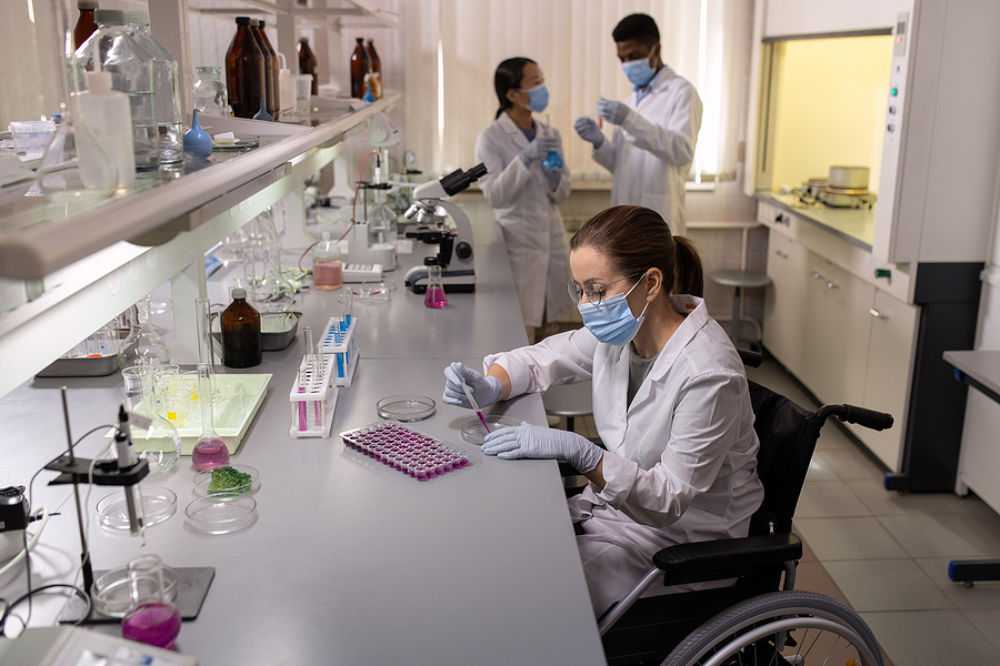 Compound chemists near me examining liquid in test tubes