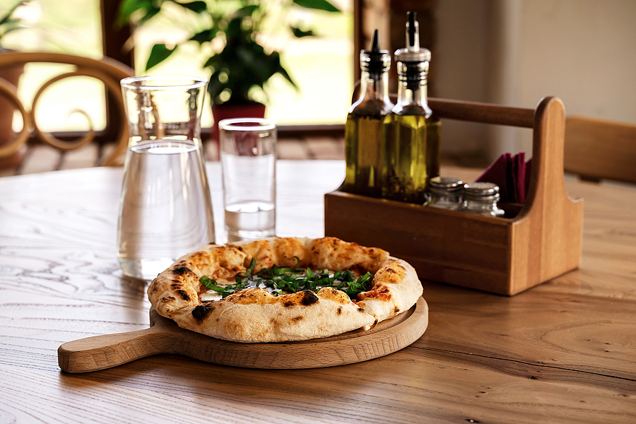 Pizza and water in glass jug