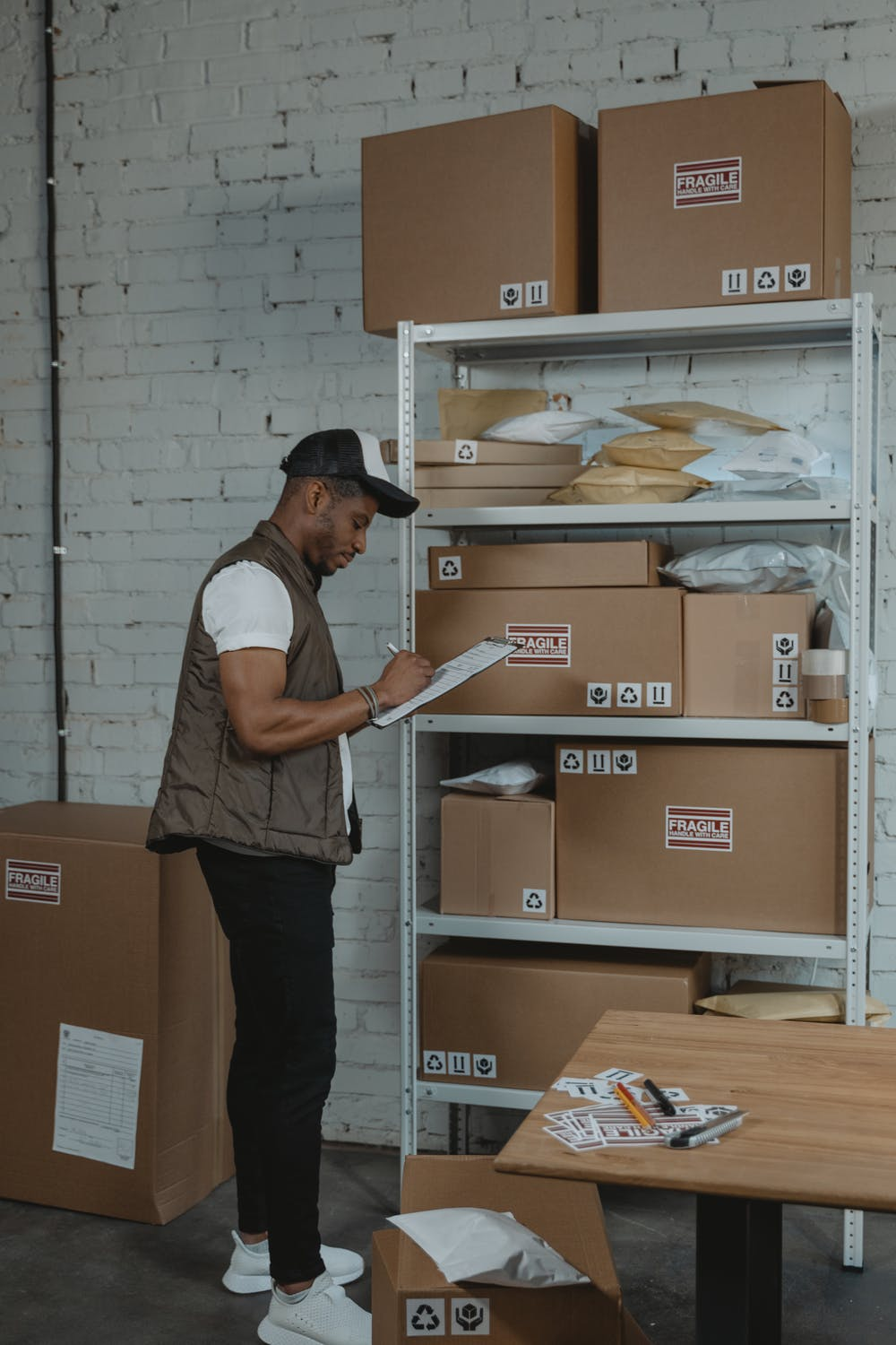 3PL company worker checking some boxes